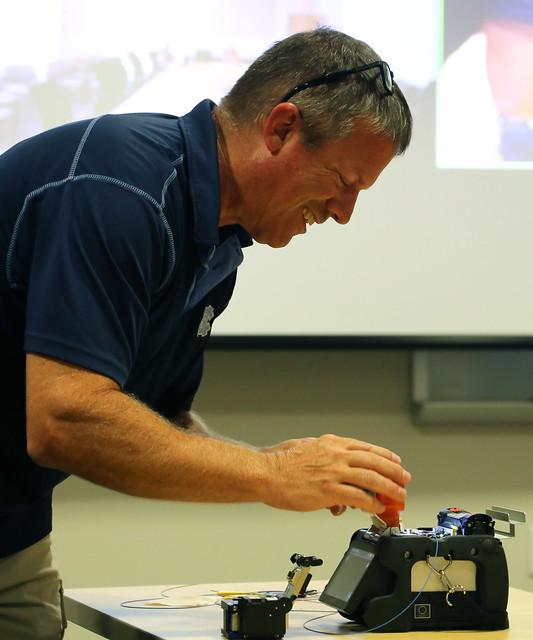 Chad Ray splices fiber cables